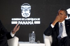 Obama rubs his eyes as he listens to his fellow speakers deliver remarks to business leaders at the CEO Summit of the Americas in Panama City, Panama