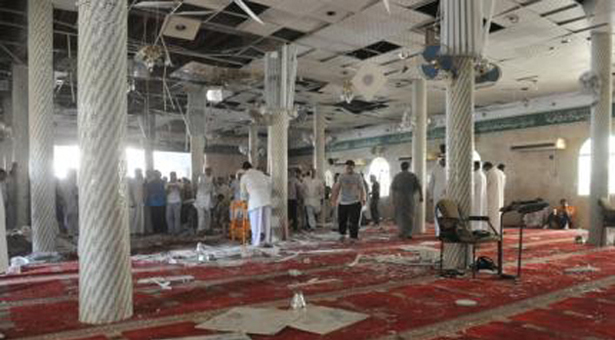 Family members of victims and well wishers are seen after a suicide bomb attack at the Imam Ali mosque in the village of al-Qadeeh in the eastern province of Gatif, Saudi Arabia, May 22, 2015. A suicide bomber blew himself up at the Shi'ite mosque in eastern Saudi Arabia during Friday prayers, residents said, killing around 20 people and wounding more than 50, local residents and a hospital officials said. REUTERS/Stringer