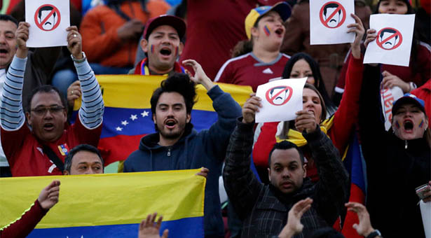 Fans of Venezuela display banners with the image of Venezuela's President Nicolas Maduro prior a Copa America Group A soccer match between Venezuela and Peru at the Elias Figueroa stadium in Valparaiso, Chile, Thursday, June 18, 2015. (AP Photo/Jorge Saenz)