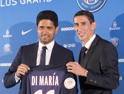 New Argentinean winger Angel Di Maria, right, and Paris Saint-Germain's Qatari president Nasser Al-Khelaifi pose with Di Maria's PSG jersey during his official presentation in Paris, France. Thursday, Aug. 6, 2015. (AP Photo/Jacques Brinon)